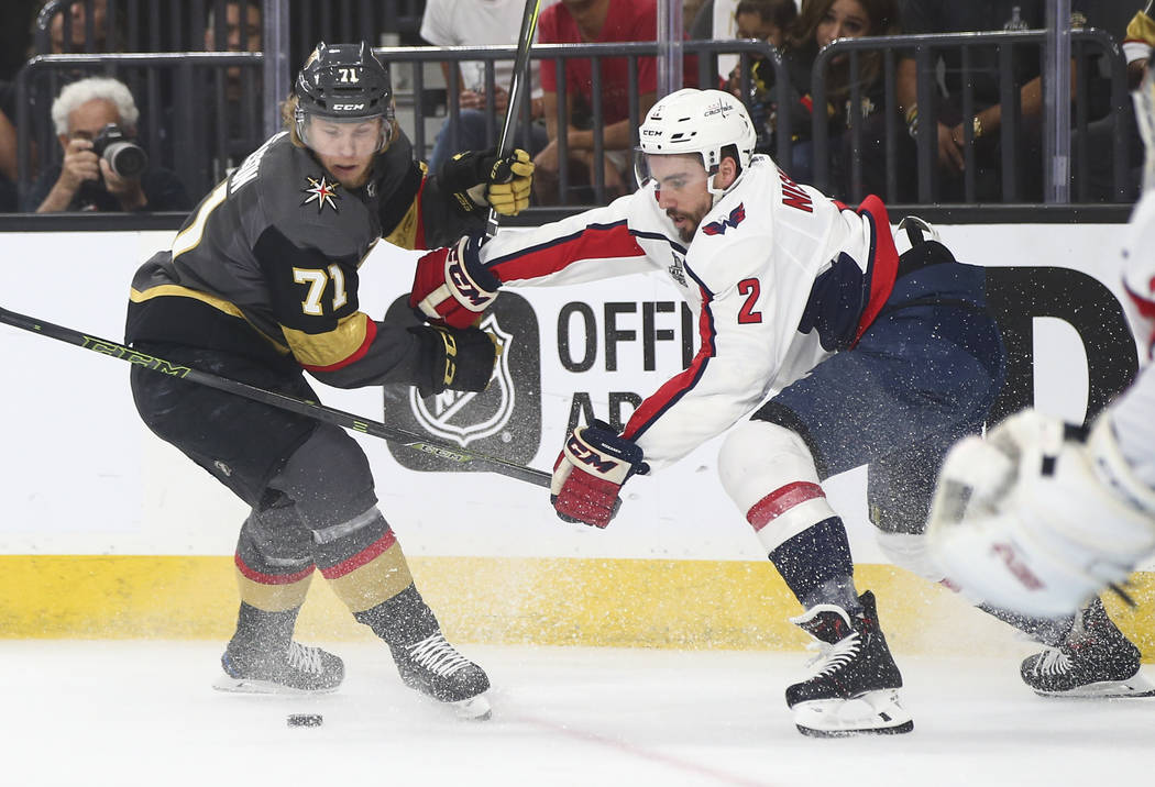 Golden Knights center William Karlsson (71) and Washington Capitals defenseman Matt Niskanen (2) battle for the puck during the first period of Game 2 of the NHL hockey Stanley Cup Final at the T- ...