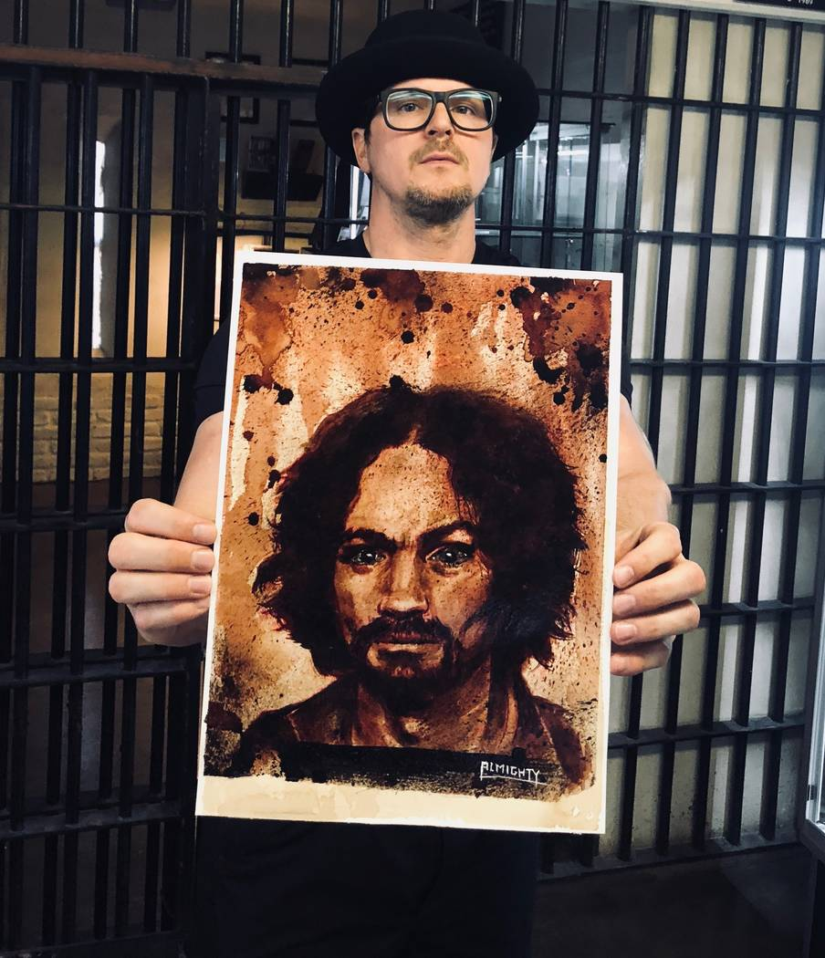 "Zak Bagans of ""Ghost Adventurers"" on Travel Channel shows a painting of Charles Manson, with Manson's ashes used for the eyes, at Zak Bagans' Haunted Museum on Saturday, July 28, 2018. (Zak Bagans ..."
