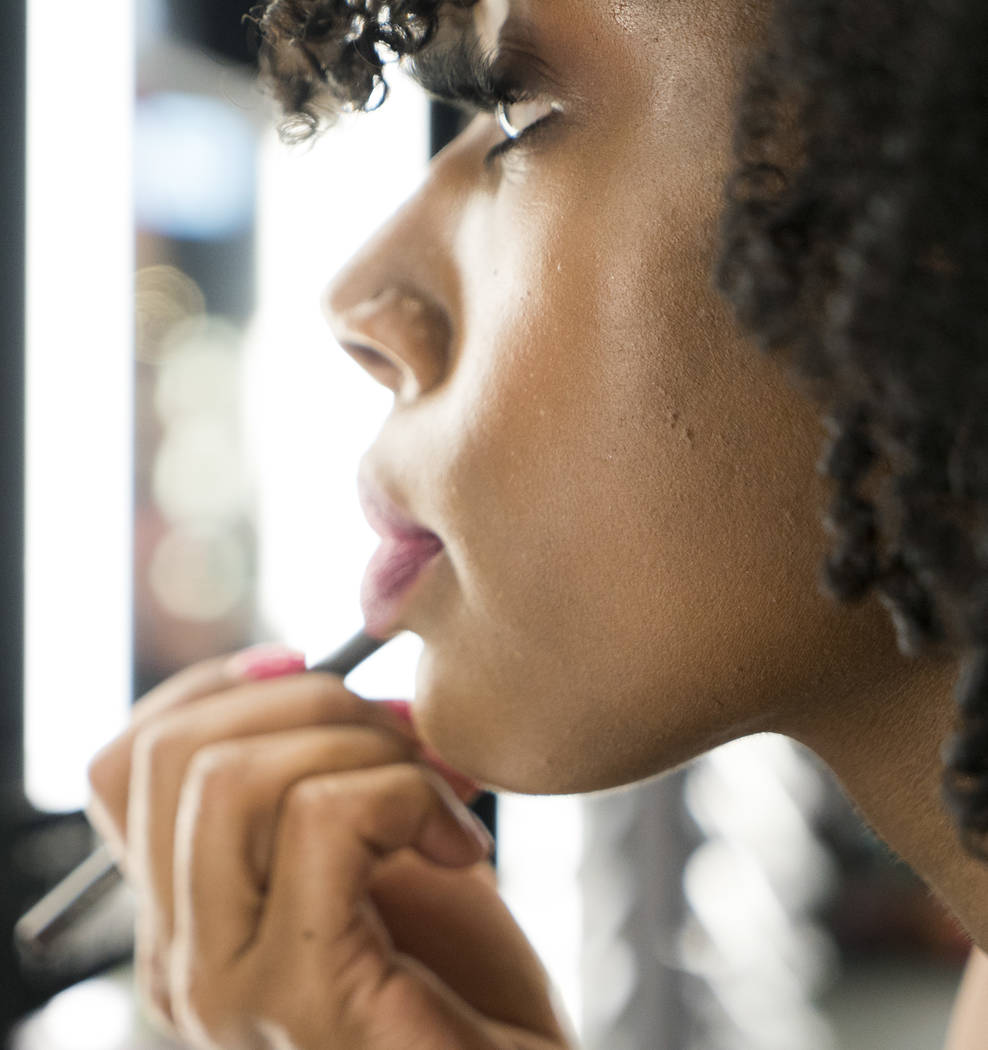 MAC beauty consultant Ellie Reed puts on makeup for National Lipstick Day at the Miracle Mile Shops in Las Vegas, Sunday, July 29, 2018. (Marcus Villagran/Las VegasReview-Journal) @brokejour ...