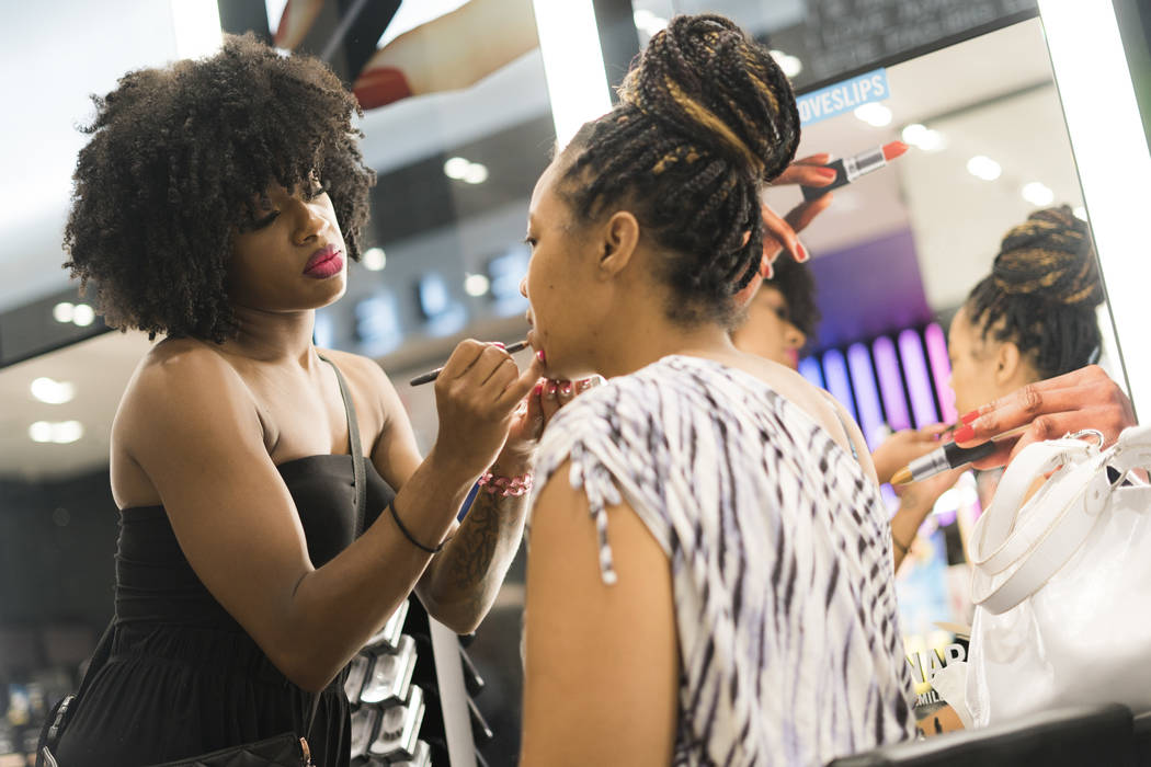 MAC beauty consultant Ellie Reed applies makeup to Amber White-Davidson for National Lipstick Day at the Miracle Mile Shops in Las Vegas, Sunday, July 29, 2018. (Marcus Villagran/Las Vegas Review- ...