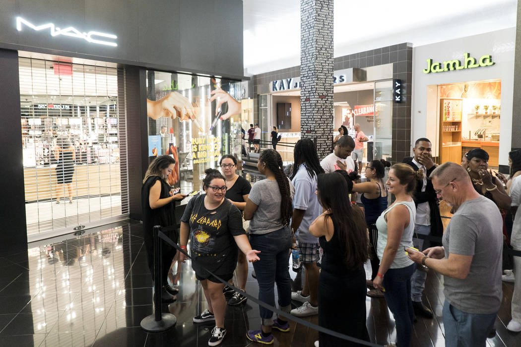 The line for free lipstick outside of MAC Cosmetics at the Miracle Mile Shops for National Lipstick Day in Las Vegas, Sunday, July 29, 2018. (Marcus Villagran/Las Vegas Review-Journal) @brokejourn ...