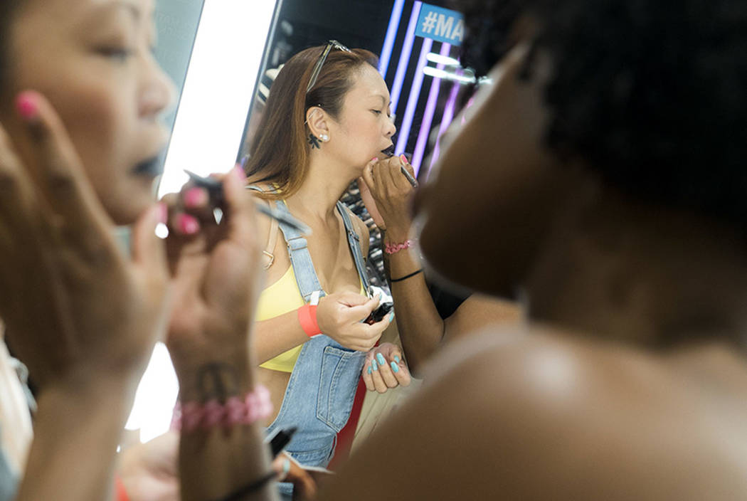 MAC beauty consultant Ellie Reed applies makeup to Jane Acero for National Lipstick Day at the Miracle Mile Shops in Las Vegas, Sunday, July 29, 2018. (Marcus Villagran/Las Vegas Review-Journal) @ ...