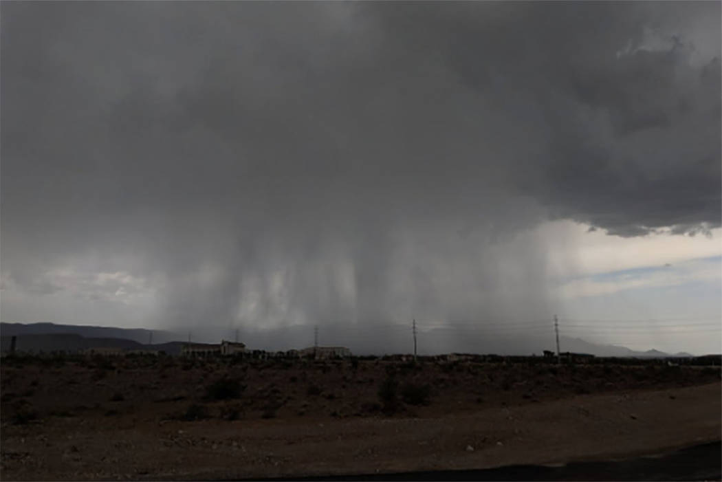 A thunderstorm comes into the Las Vegas Valley from the Spring Mountains on July 29. (Richard Brian/Las Vegas Review-Journal)