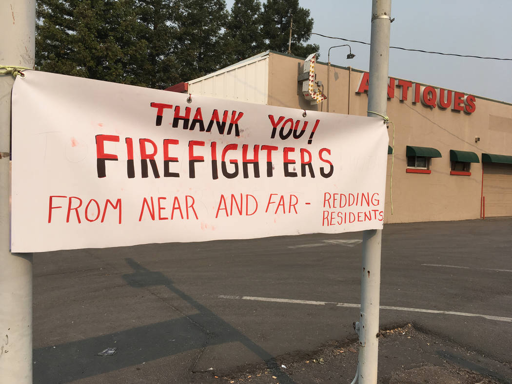A sign thanking firefighters is see in Redding, Calif., Sunday, July 29, 2018. Fire crews faced many uncertainties Sunday as they struggled to corral a deadly blaze in Northern California that lef ...