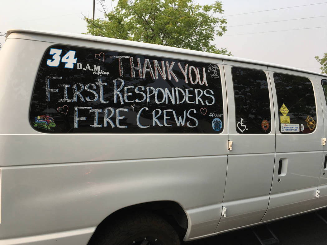 A thank you to fire crews and first responders is shown on a van in Redding, Calif., Sunday, July 29, 2018. Fire crews faced many uncertainties Sunday as they struggled to corral a deadly blaze in ...