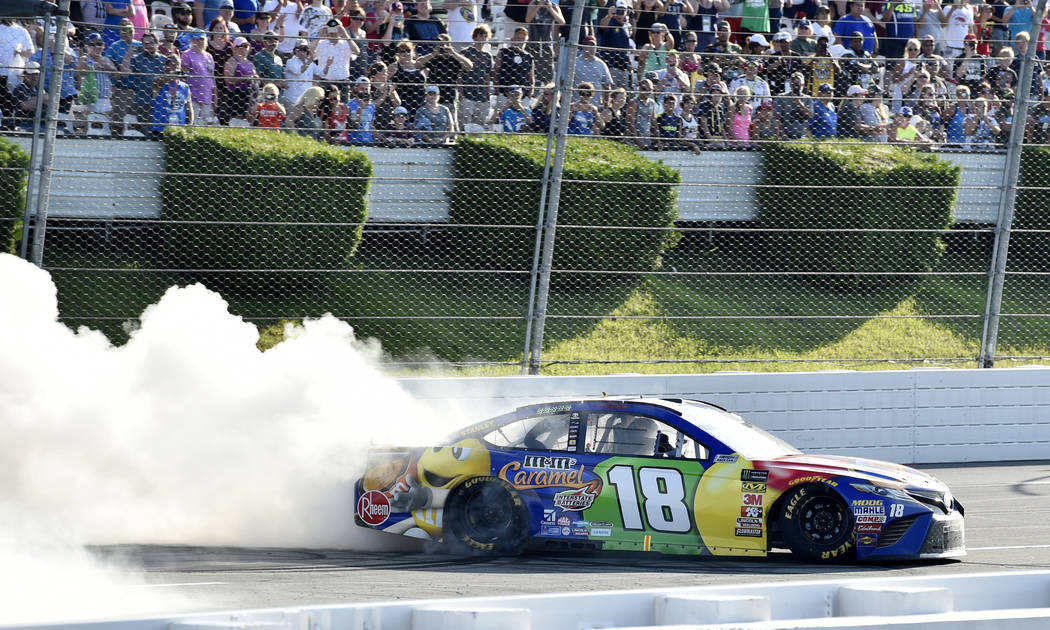 Kyle Busch celebrates with a burnout after winning a NASCAR Cup Series auto race, Sunday, July 29, 2018, in Long Pond, Pa. (AP Photo/Derik Hamilton)