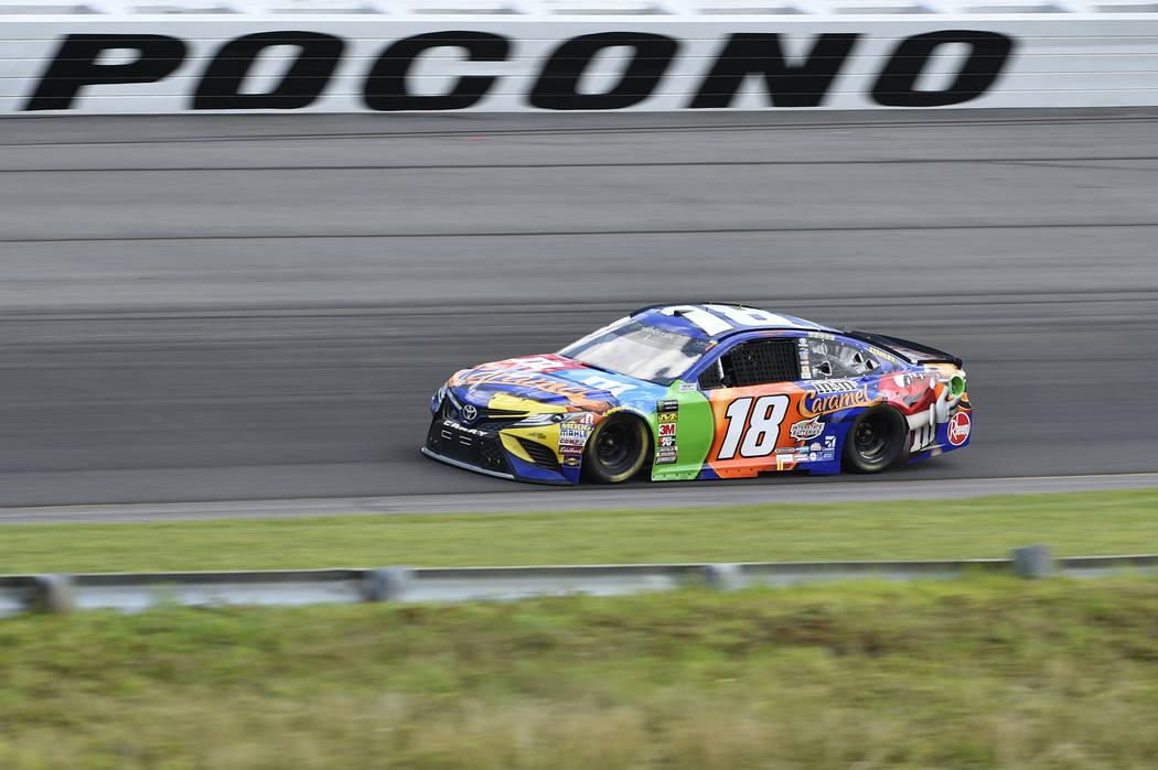 Kyle Busch drives through Turn 1 during a NASCAR Cup Series auto race, Sunday, July 29, 2018, in Long Pond, Pa. Busch won the race. (AP Photo/Derik Hamilton)