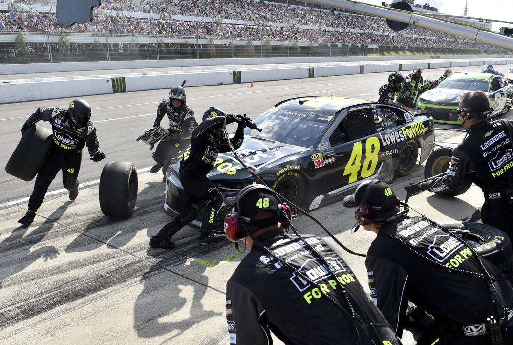 Jimmie Johnson makes a pit stop during a NASCAR Cup Series auto race, Sunday, July 29, 2018, in Long Pond, Pa. Kyle Busch won the race. (AP Photo/Derik Hamilton)