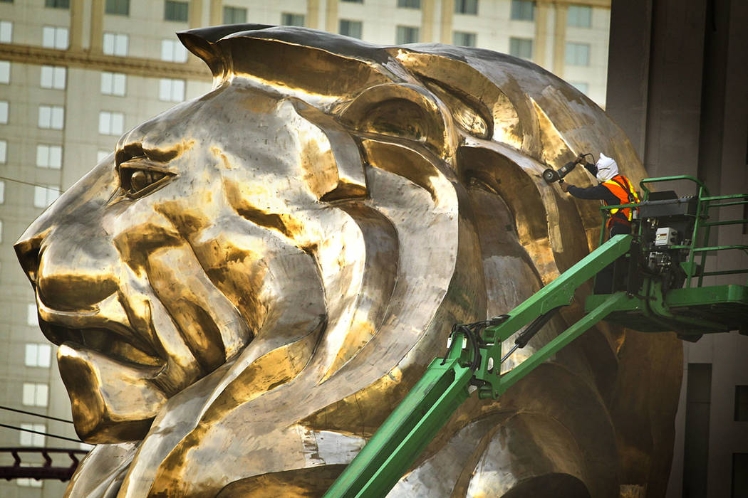 A workman grinds on the MGM Grand lion statue in front of the hotel, 3799 S. Las Vegas Boulevard, in 2013. (Las Vegas Review-Journal)