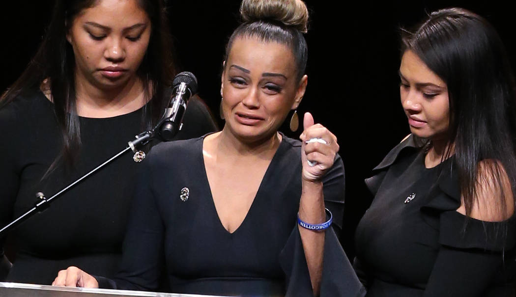 Daughters of Las Vegas Corrections Officer Kyle Eng, from left, Kayla Eng, Alexa Untalasco and Alyssa Eng, during funeral services for their father at Canyon Ridge Christian Church Monday, Ju ...