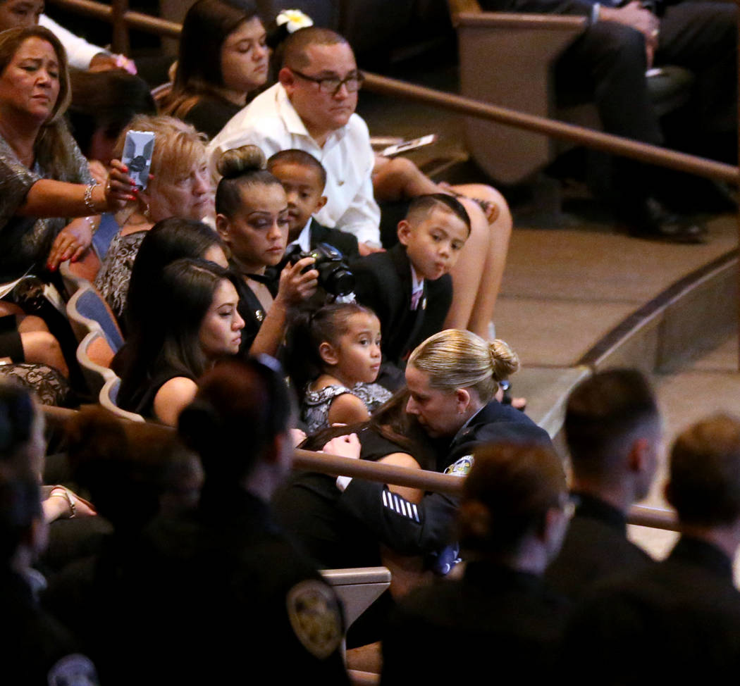 Michele Freeman, chief of Las Vegas Department of Public Safety, hugs widow Arlyn Eng during funeral services for Las Vegas Corrections Officer Kyle Eng at Canyon Ridge Christian Church Monday, Ju ...