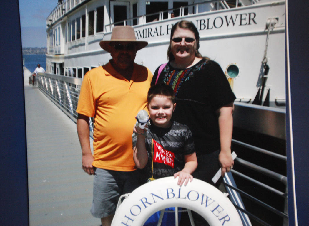 A photo of Daemion Olsen, 9, with his parents Jeffrey Olsen and Carrie Olsen on a recent trip to San Diego at his home in Las Vegas, Tuesday, July 31, 2018. Medicaid announced a new rule in June t ...