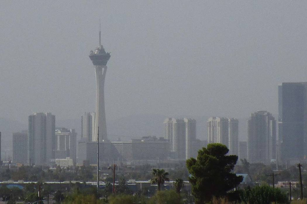 Brilliant blue skies have been replaced by a haze over the Las Vegas Valley on Tuesday, July 31, 2018, in this view from West Brooks Avenue and Clayton Street just east of the North Las Vegas airp ...