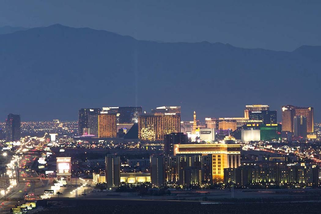 Resorts on the Strip light up at dusk in Las Vegas on Monday, July 30, 2018. Richard Brian Las Vegas Review-Journal @vegasphotograph
