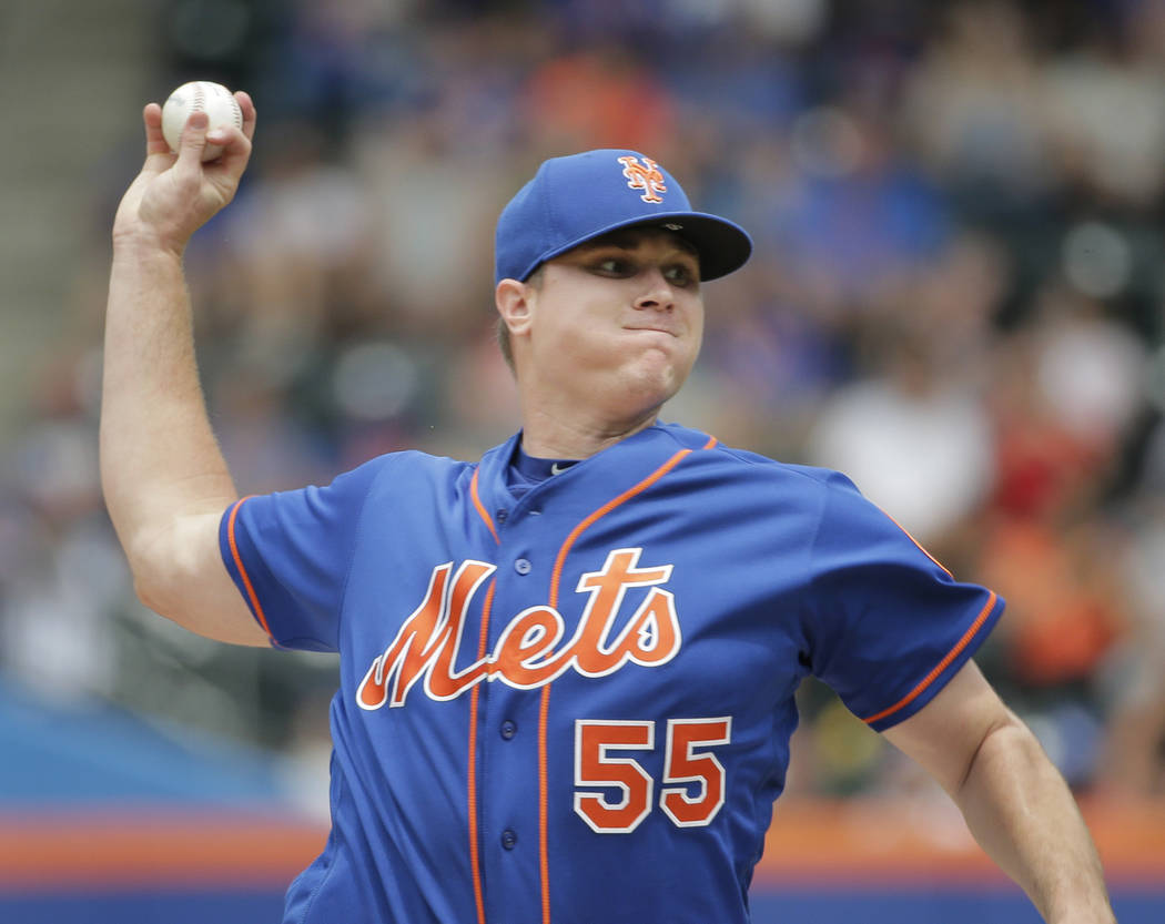 New York Mets pitcher Corey Oswalt throws during the first inning of the baseball game against the Washington Nationals at Citi Field, Sunday, July 15, 2018, in New York. (AP Photo/Seth Wenig)