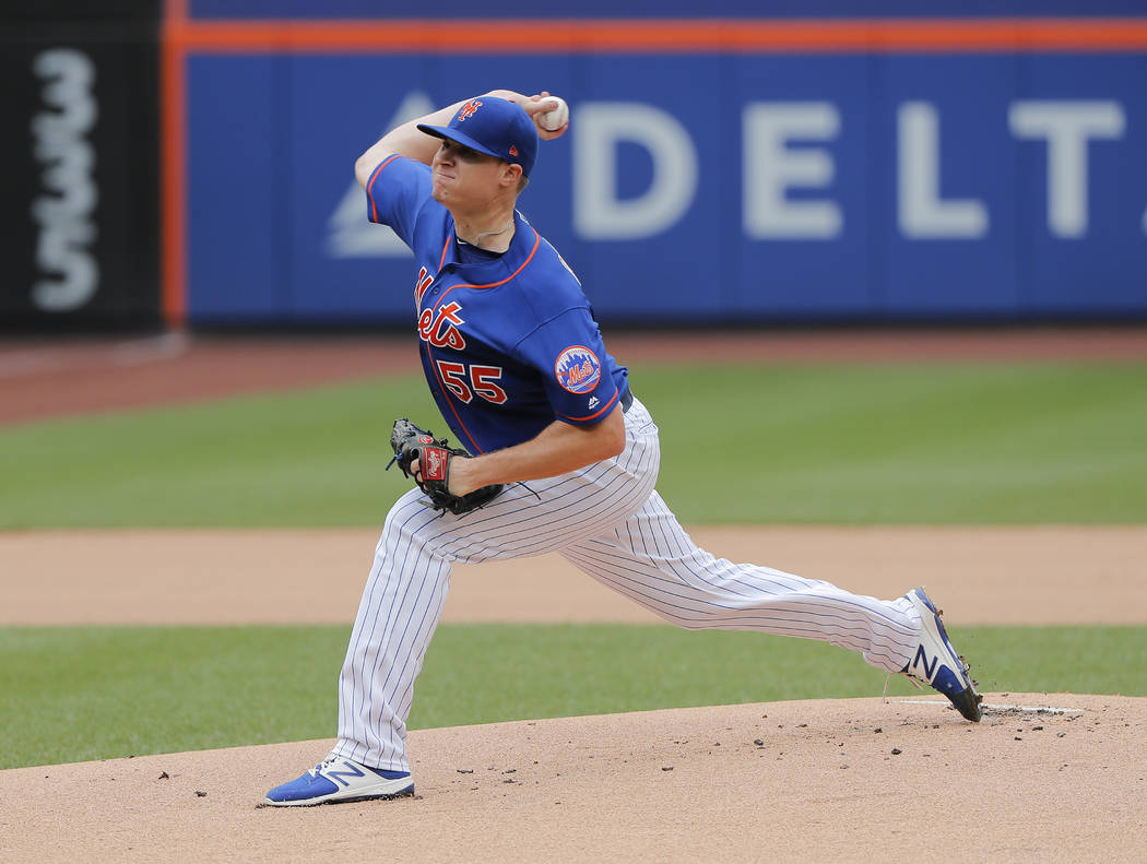 New York Mets pitcher Corey Oswalt (55) delivers against the San Diego Padres during the first inning of a baseball game, Wednesday, July 25, 2018, in New York. The Mets won 6-4. (AP Photo/Julie J ...