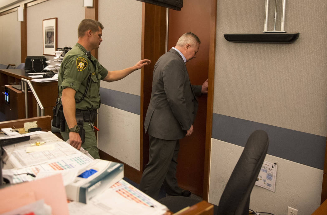 Jarom Boyes, right, an Air Force sergeant, charged in the shooting death of his wife, exits the courtroom after he was found guilty of involuntary manslaughter at the Regional Justice Center in do ...