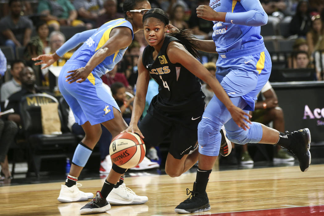 Las Vegas Aces guard Moriah Jefferson (4) drives the ball in front of Chicago Sky forward Cheyenne Parker (32) during the second half of a WNBA basketball game at Mandalay Bay Events Center in Las ...