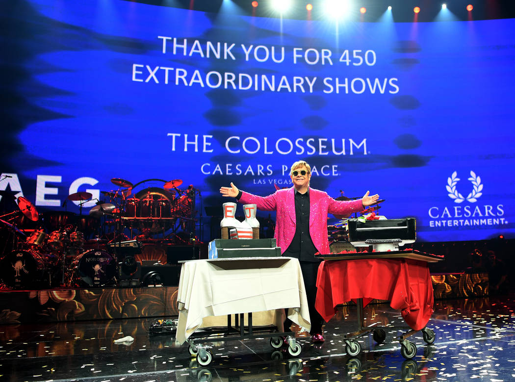 """Elton John is shown with a pair of cakes at the close of his final performance of """"Million Dollar Piano"""" at the Colosseum at Caesars Palace on Thursday, May 17, 2018. (Denise Truscello)"""