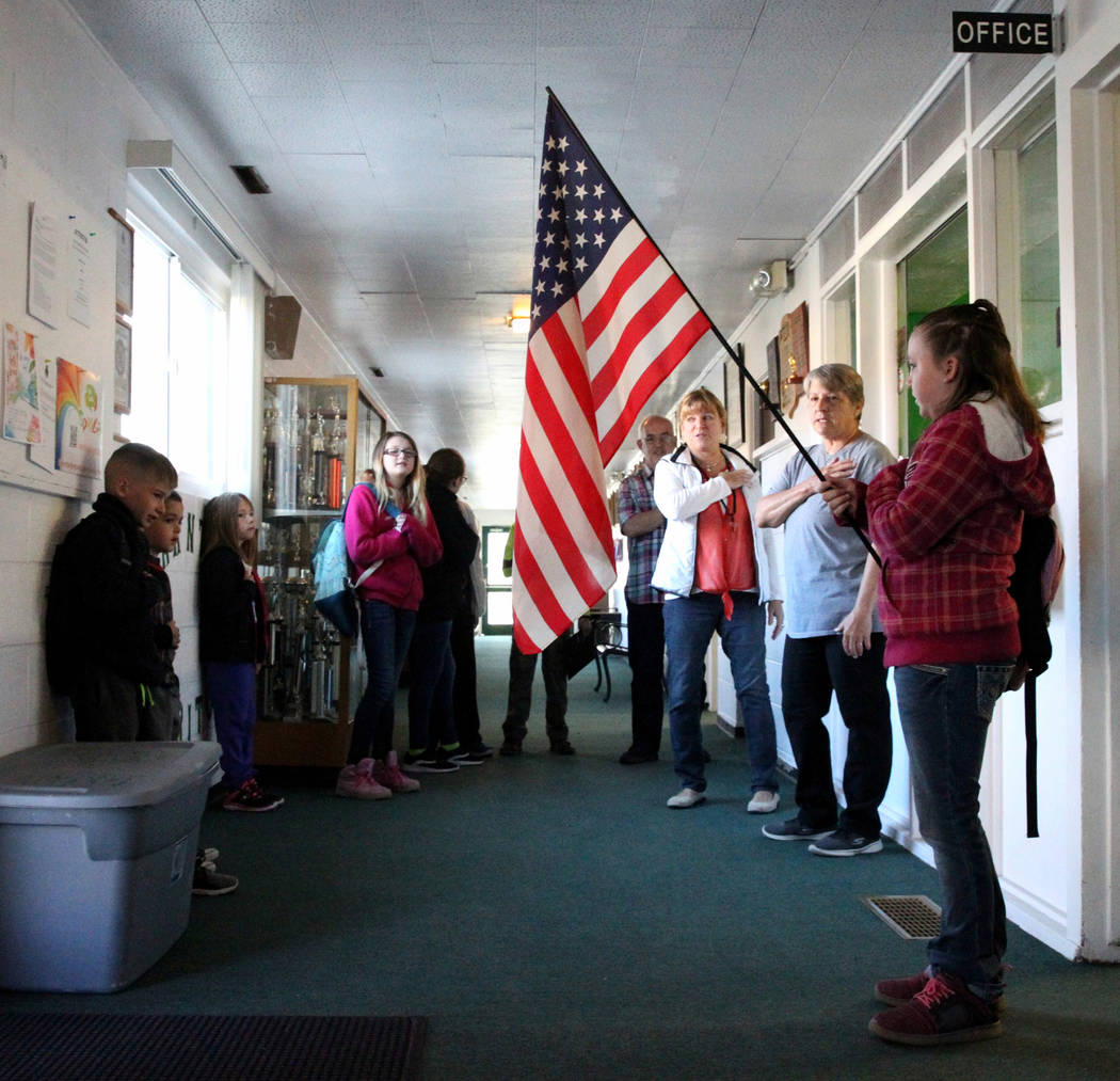 Sierra McKinnon, 9, holds the flag as all K-12th grade students recite the Pledge of Allegiance at Gabbs schools Monday, April, 9, 2018. K.M. Cannon Las Vegas Review-Journal @KMCannonPhoto