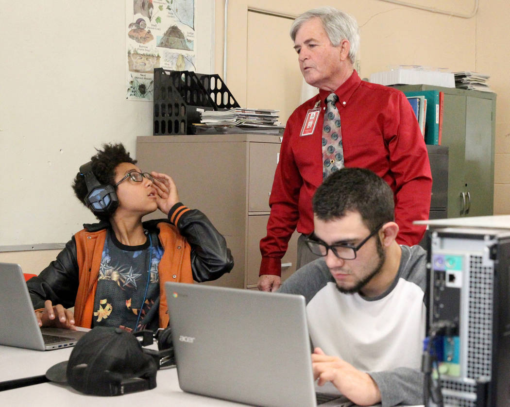 Gabbs schools students 8th grader Timothy Howell, 13, left, and junior Jorge Martinez, 17, do course work online with the help of teacher Tom Lyman at the school Monday, April, 9, 2018. K.M. Canno ...