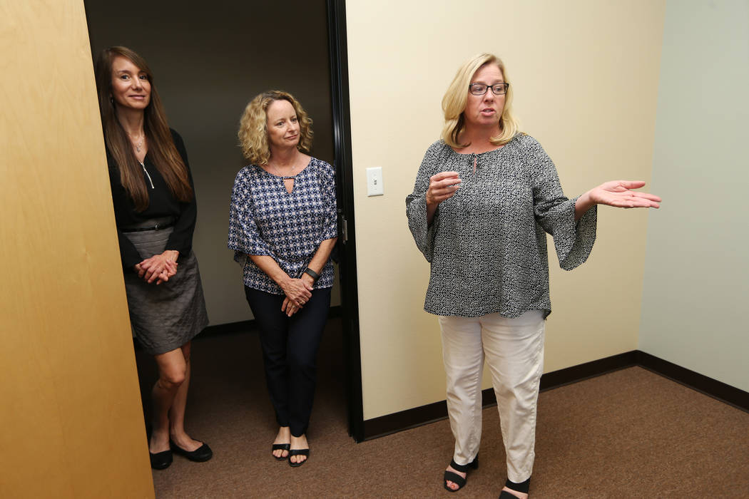 Center for Hope's CEO Amy Gerberry, right, registered dietitian Lisa Contreras, far left, and registered diabetes educator and dietitian Mary Dunaway, tour the newly opened Center for Hope, an eat ...