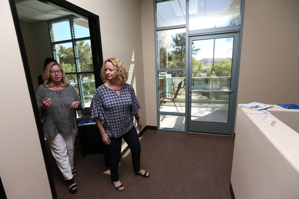 Center for Hope's CEO Amy Gerberry, left, and registered diabetes educator and dietitian Mary Dunaway, tour the newly opened Center for Hope, an eating disorder treatment facility, during an open ...