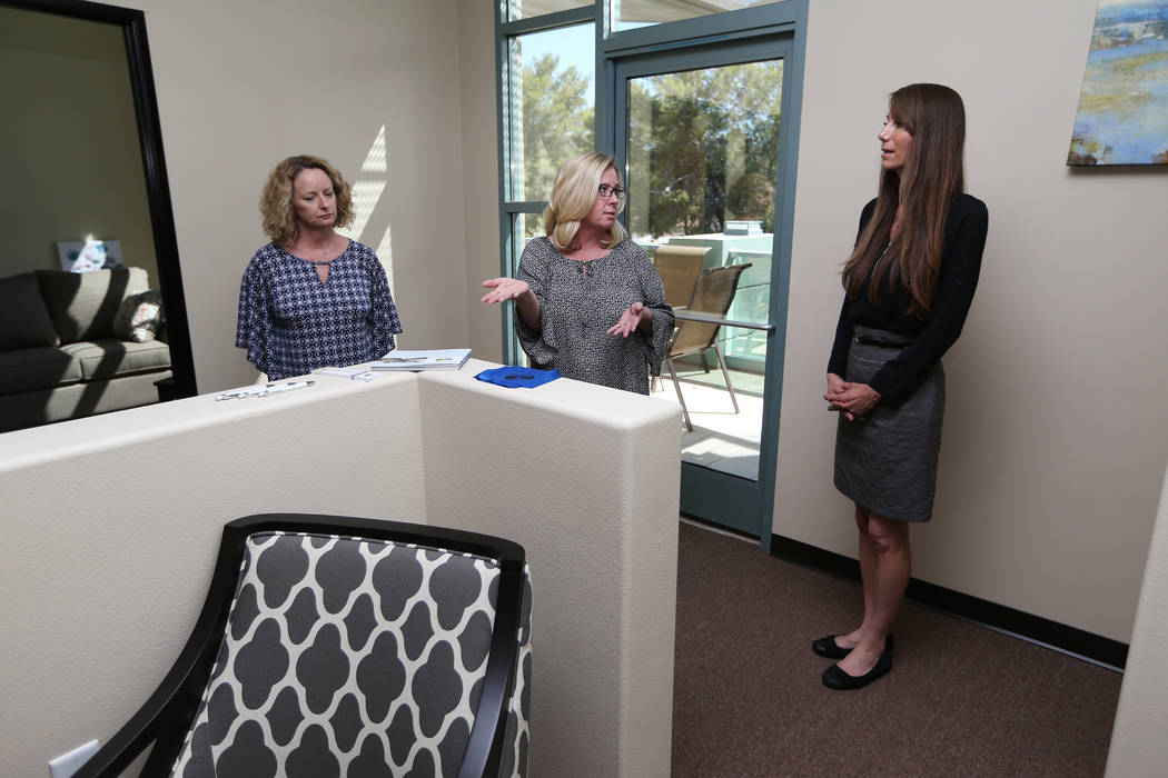 Center for Hope's CEO Amy Gerberry, center, registered dietitian Lisa Contreras, right, and registered diabetes educator and dietitian Mary Dunaway, tour the newly opened Center for Hope, an eatin ...