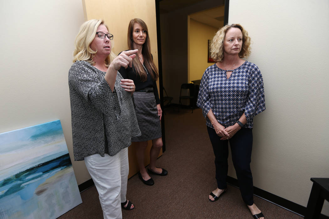 Center for Hope's CEO Amy Gerberry, from left, registered dietitian Lisa Contreras, and registered diabetes educator and dietitian Mary Dunaway, tour the newly opened Center for Hope, an eating di ...