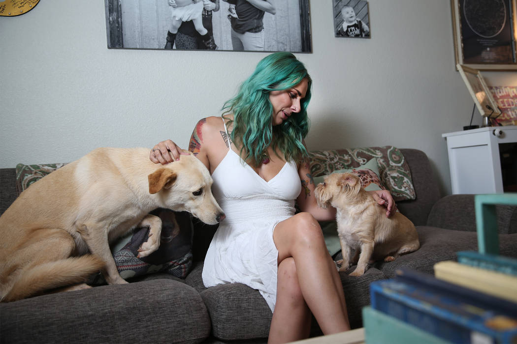Cassi Davis, organizer of the Las Vegas Crush Run, with her dogs at her home in Las Vegas, Friday, July 13, 2018. Davis was diagnosed with depression and anxiety after her second child was born an ...