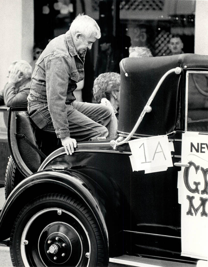 Paul Laxalt climbs into a rumble seat for his postion as grand marshal on November 1, 1986 . (Wayne Kodey/Las Vegas Review-Journal )