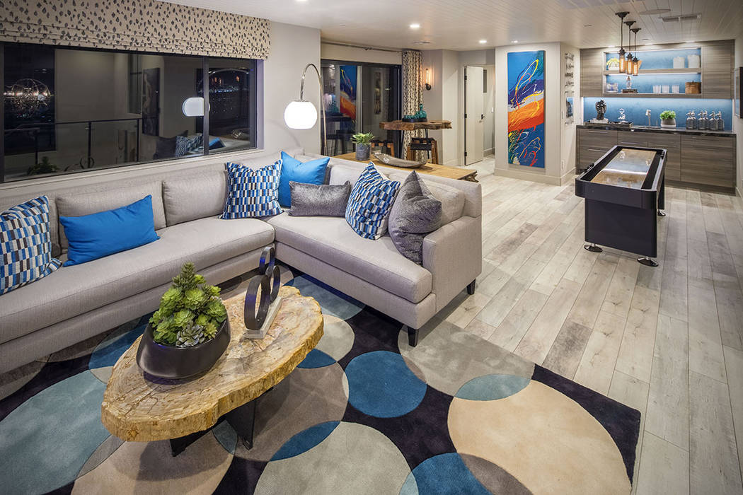 The family room leads to a balcony with views of the Strip. (Christopher Homes)