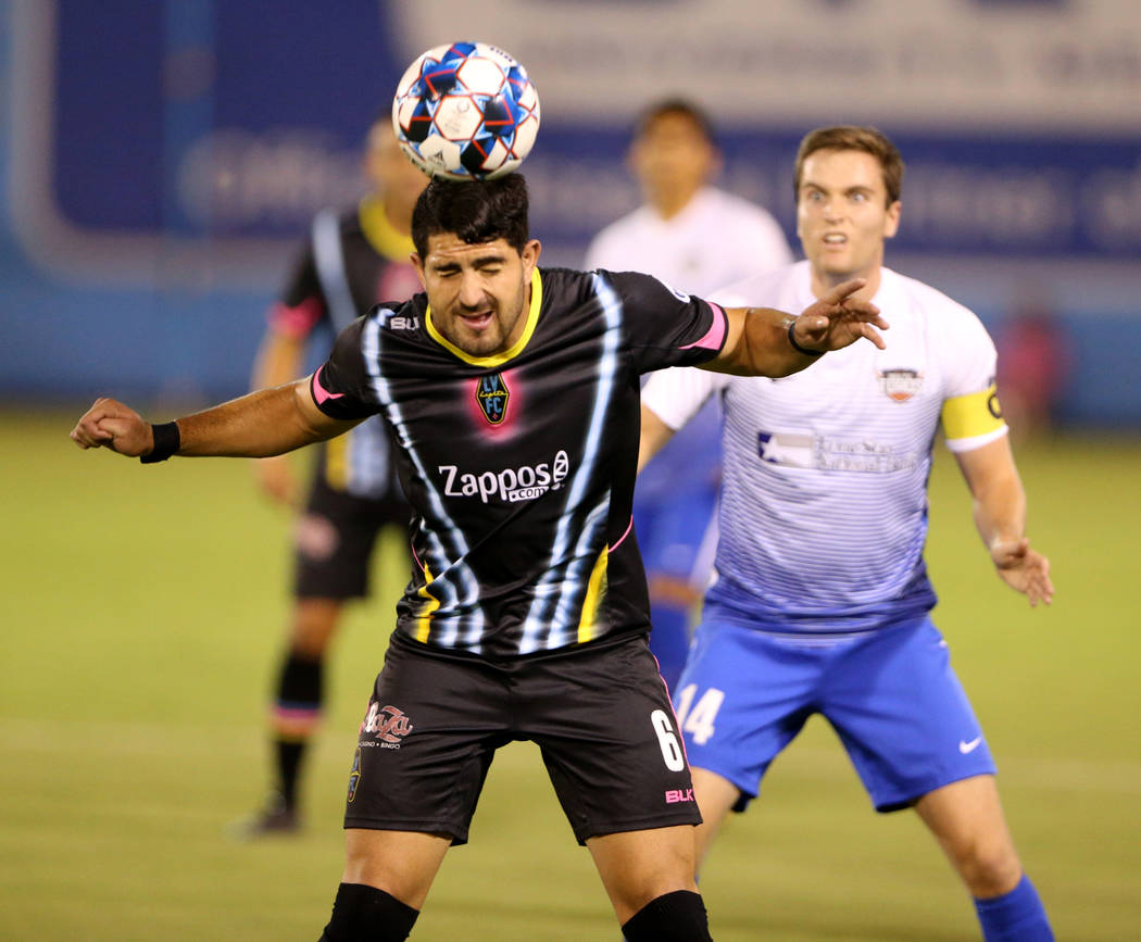 Las Vegas Lights FC defender Marco Cesar Jaime Jr. (6) head the ball in front of Rio Grande Valley FC Toros midfielder Todd Wharton (14) in the first half of a soccer game at Cashman Field in Las ...