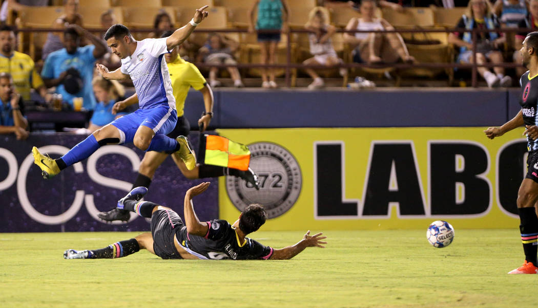 Las Vegas Lights FC defender Rodrigo Inigo (4) clears the ball in the first half of a soccer game at Cashman Field in Las Vegas on Saturday, Aug. 4, 2018. K.M. Cannon Las Vegas Review-Journal @KMC ...