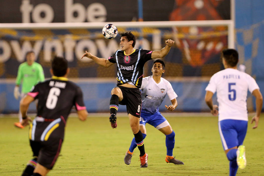 Las Vegas Lights FC forward Omar Salgado (8) heads the ball in front of Rio Grande Valley FC Toros defender Omar Ontiveros (30) in the first half of a soccer game at Cashman Field in Las Vegas on ...