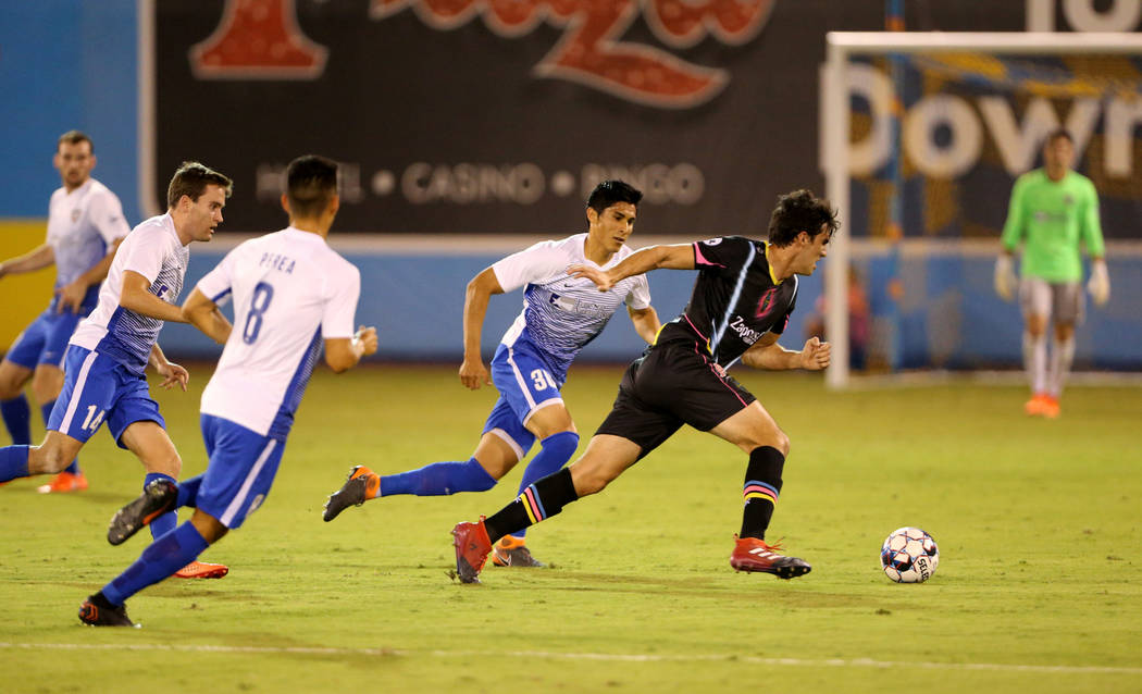 Las Vegas Lights FC forward Omar Salgado (8) moves the ball in front of Rio Grande Valley FC Toros defender Omar Ontiveros (30) in the first half of a soccer game at Cashman Field in Las Vegas on ...