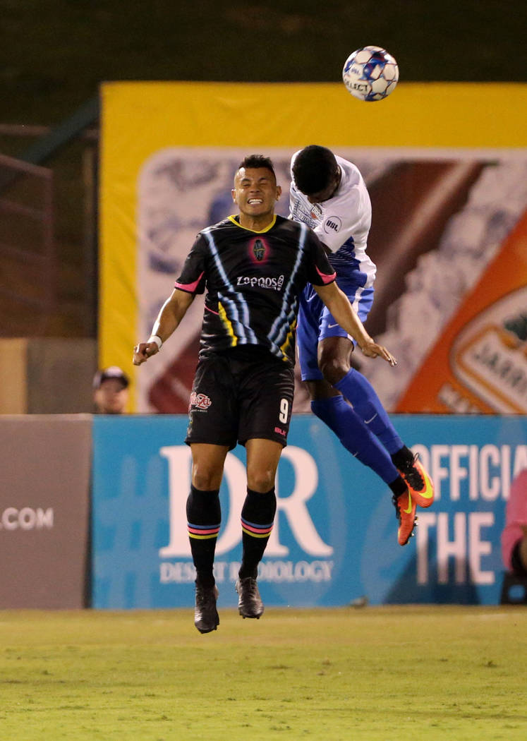 Las Vegas Lights FC forward Sammy Ochoa (9) heads the ball in the first half of a soccer game at Cashman Field in Las Vegas on Saturday, Aug. 4, 2018. K.M. Cannon Las Vegas Review-Journal @KMCanno ...
