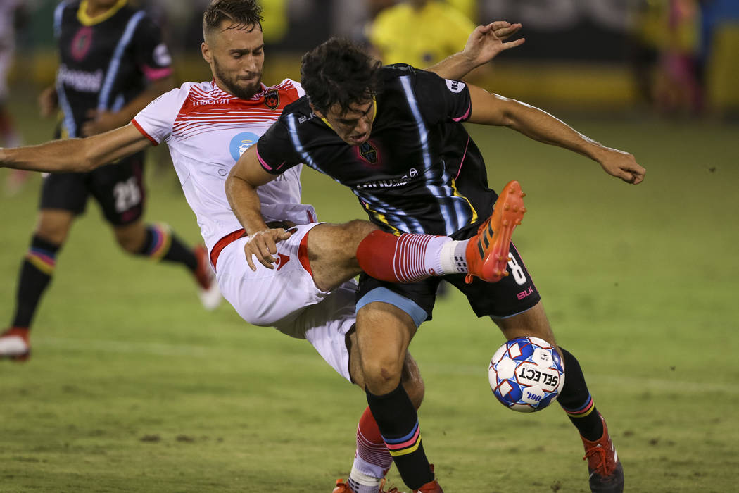 Phoenix Rising FC defender Joseph Farrell (15), left, and Light FC forward Omar Salgado (8) vie for the ball during the second half of a United Soccer League match at Cashman Field in downtown Las ...