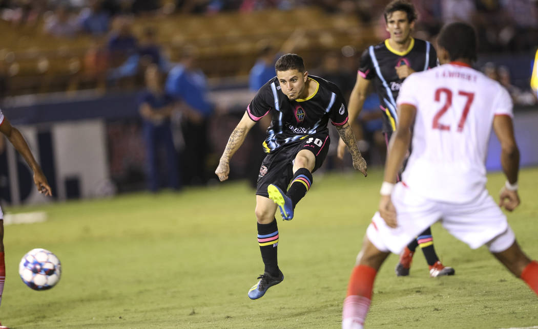 Light FC forward Raul Mendiola (40) takes a shot against Phoenix Rising FC midfielder Kevon Lambert (27) during the second half of a United Soccer League match at Cashman Field in downtown Las Veg ...