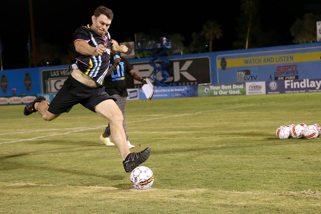Retired mixed martial artist and a UFC Hall of Famer Forrest Griffin kicks a soccer ball while participating in halftime activities during the Light FC and Phoenix Rising FC United Soccer League m ...