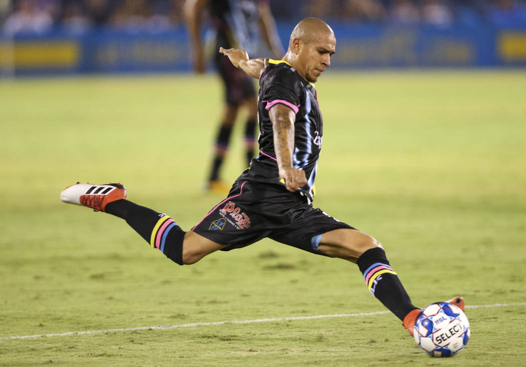 Light FC midfielder Rafael Garcia (25) kicks the ball against Phoenix Rising FC defenders during the first half of a United Soccer League match at Cashman Field in downtown Las Vegas on Saturday, ...