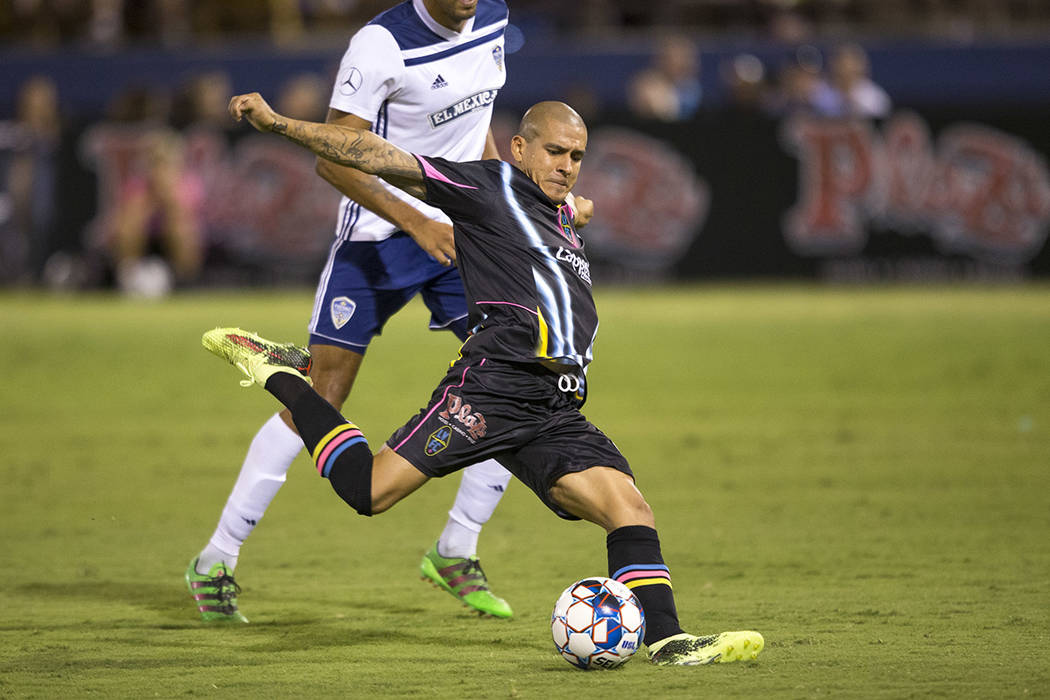 Las Vegas Lights FC midfielder Rafael Garcia (25) shoots for a goal against Fresno FC during the second half of a United Soccer League match at Cashman Field in downtown Las Vegas on Saturday, Aug ...