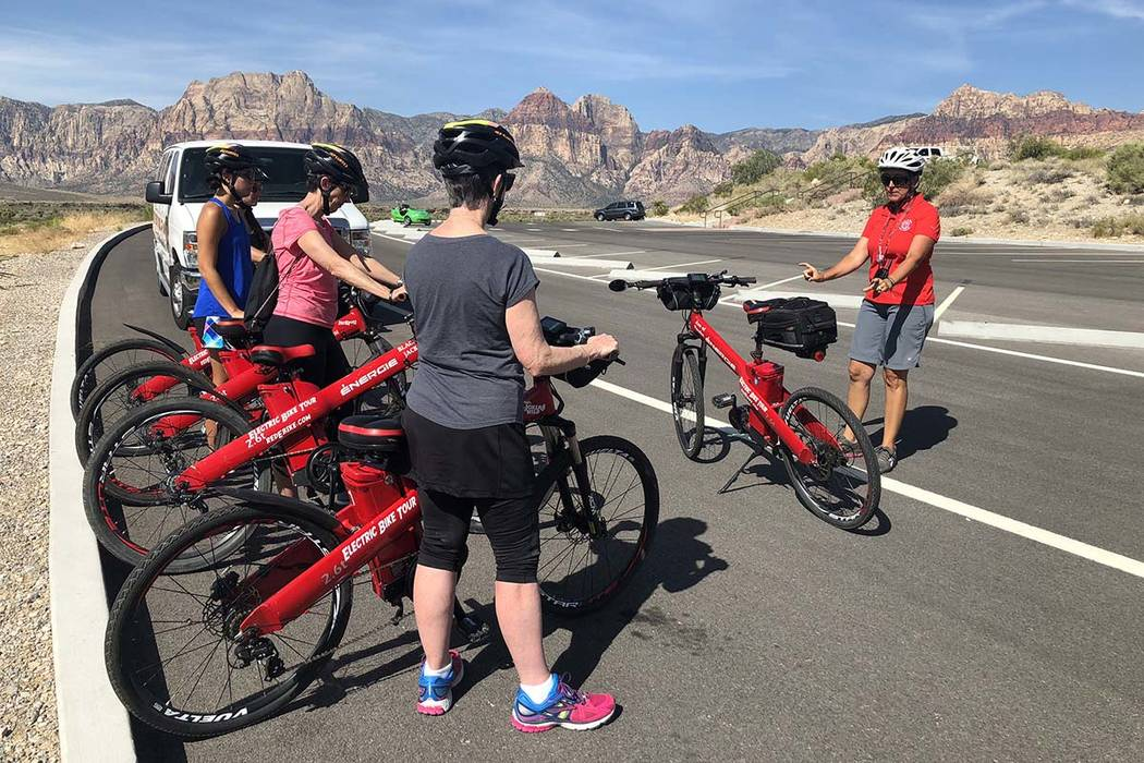 Allison Messmore, far right, explains to a group of tourists how to operate an electric bike before taking them on a guided tour through Red Rock National Conservation Area on Friday, July 20, 201 ...
