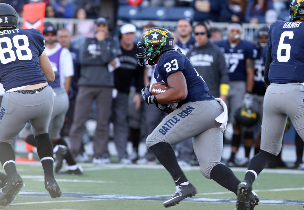 Nevada Wolf Pack running back Kelton Moore (23) carries the football against the UNLV Rebels during the first half of their game in Reno, Saturday, Nov. 25, 2017. Heidi Fang Las Vegas Review-Journ ...