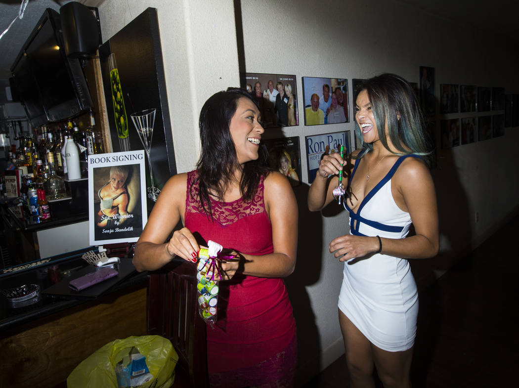 Prostitutes Cee Mia, left, and Jade Monroe talk before a birthday celebration at the Love Ranch brothel in Crystal, just north of Pahrump, on Friday, July 20, 2018. Chase Stevens Las Vegas Review- ...