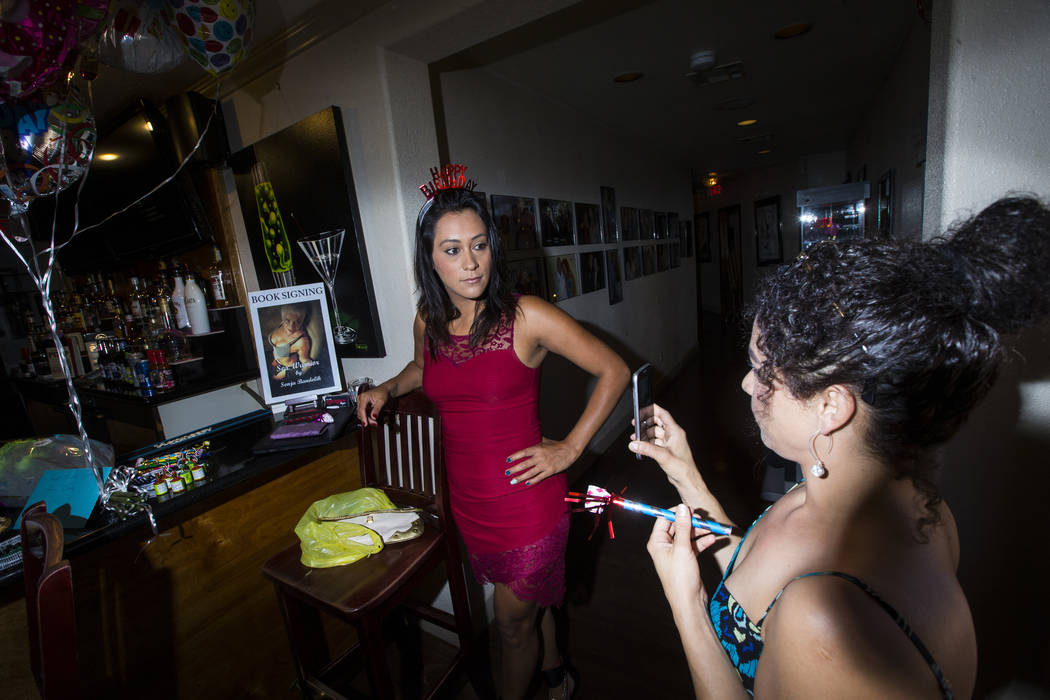 Prostitutes Cee Mia, left, and Dasha Dare talk before a birthday celebration at the Love Ranch brothel in Crystal, just north of Pahrump, on Friday, July 20, 2018. Chase Stevens Las Vegas Review-J ...