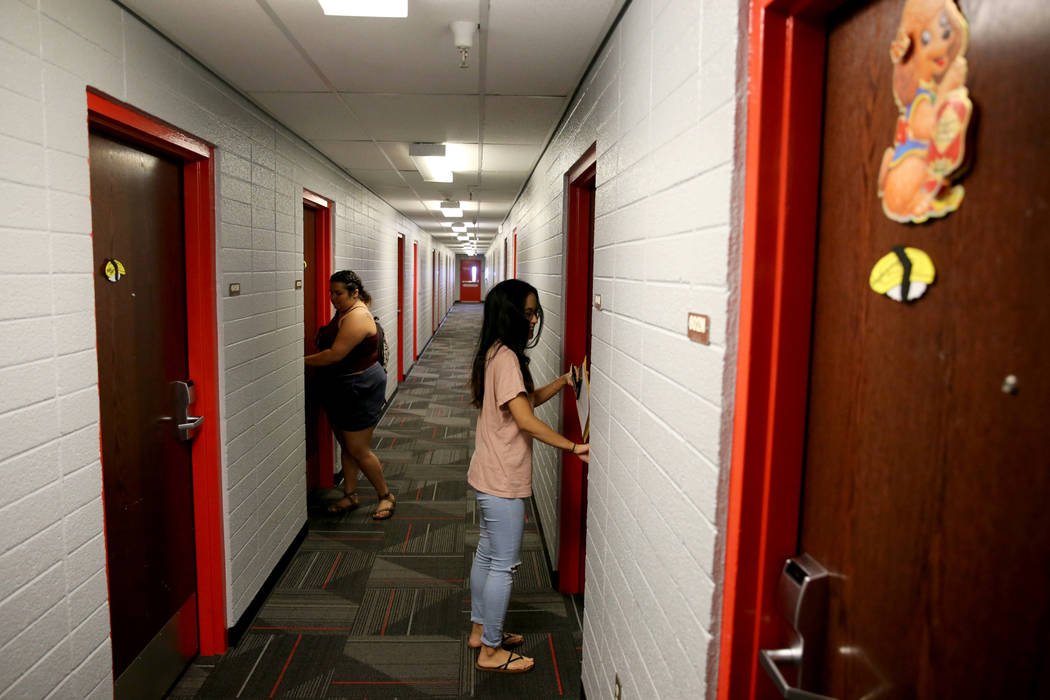 UNLV senior Angelyn Tabalba, right, enters her dorm room in the Tonopah Complex Thursday, July 26, 2018. K.M. Cannon Las Vegas Review-Journal @KMCannonPhoto