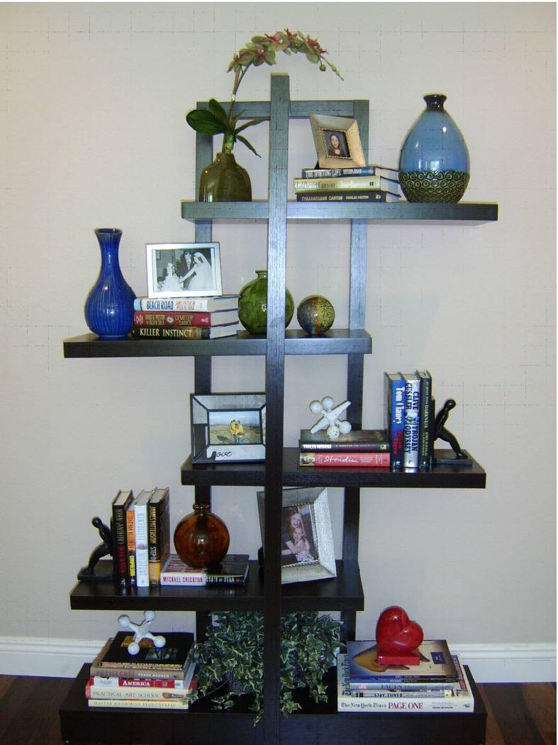Shelves aren't just for books. Intersperse a variety of different-sized accessories for visual interest. (GMJ Interiors)