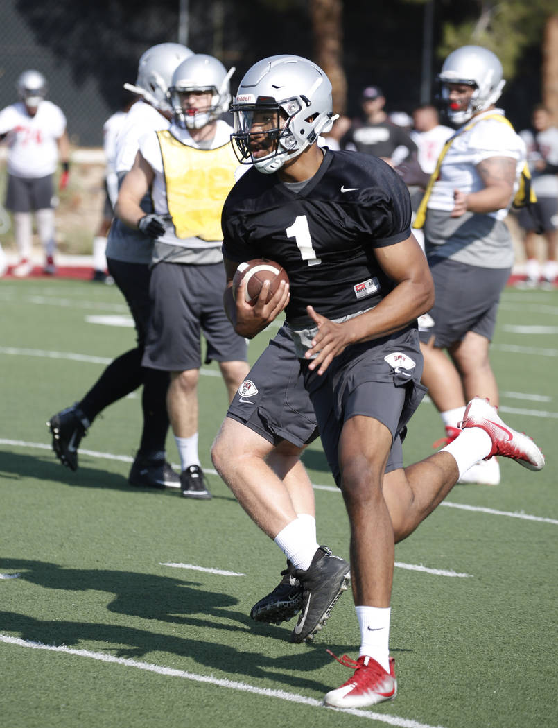UNLV quarterback Armani Rogers runs with the ball during team practice on Friday, Aug. 3, 2018, in Las Vegas. Bizuayehu Tesfaye/Las Vegas Review-Journal @bizutesfaye