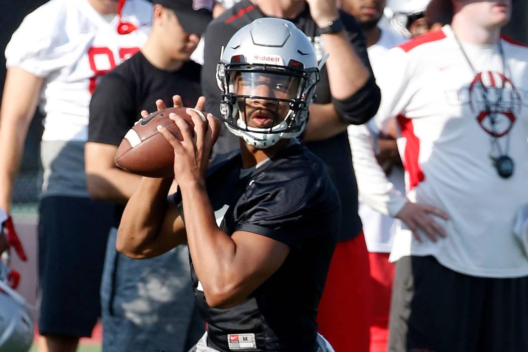 UNLV quarterback Armani Rogers prepares to throw the ball during team practice on Friday, Aug. 3, 2018, in Las Vegas. Bizuayehu Tesfaye/Las Vegas Review-Journal @bizutesfaye